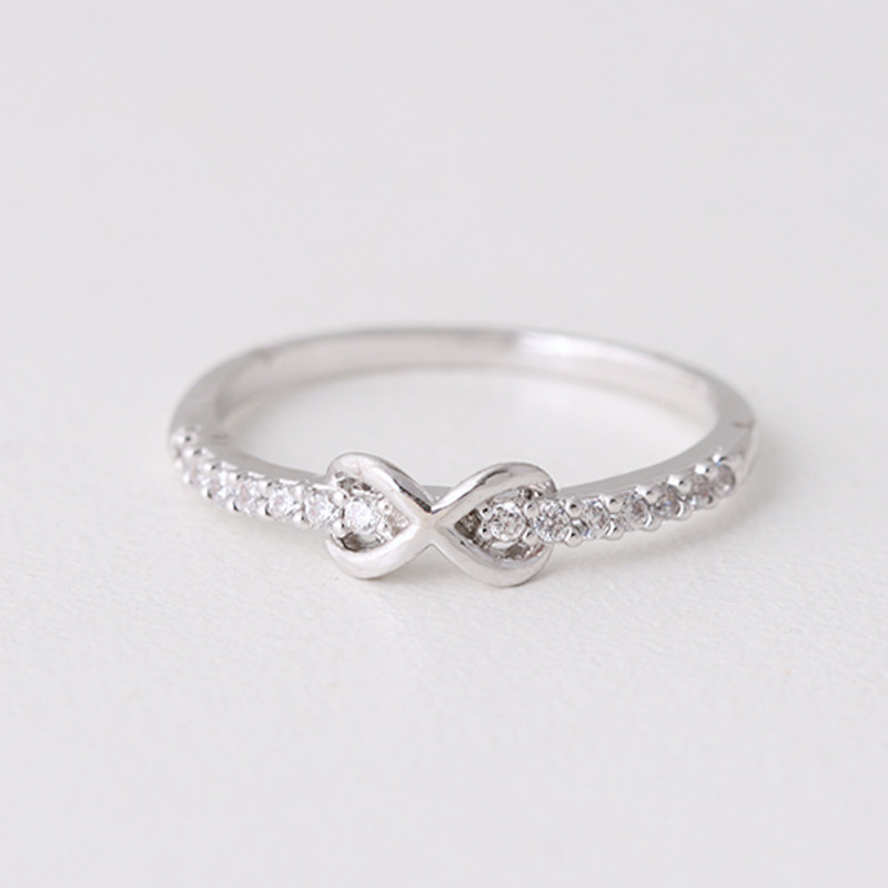 CZ Band Embraced Infinity Symbol Ring White Gold from kellinsilver.com