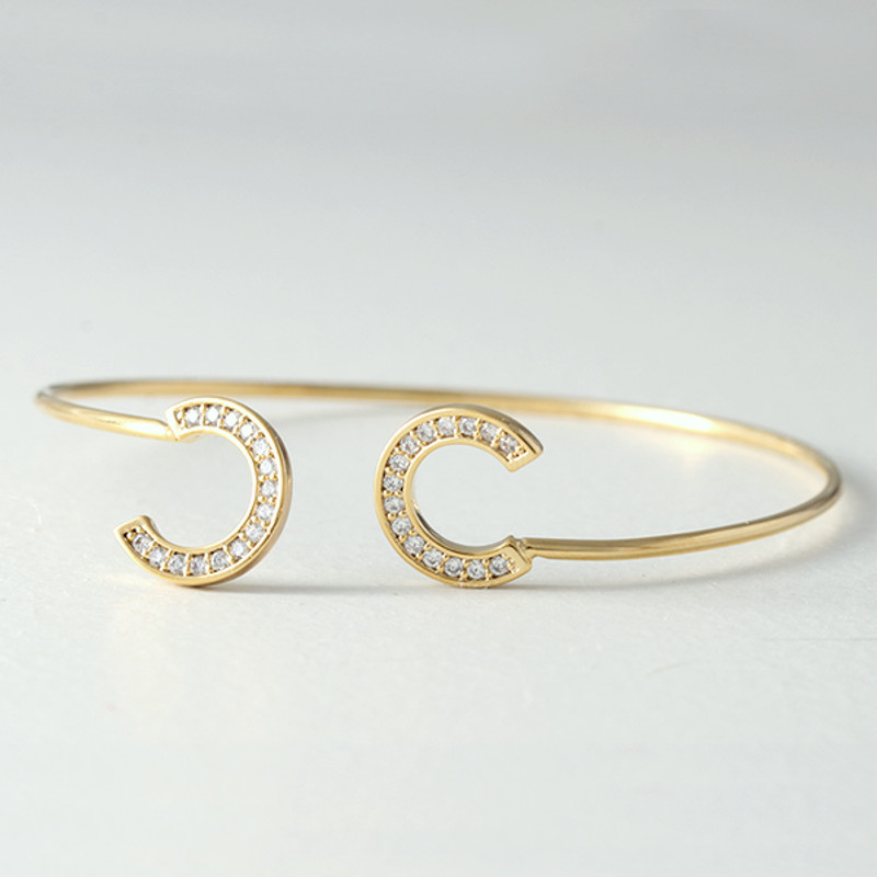 Swarovski Gold Horseshoe Knot Bangle Bracelet  from kellinsilver.com