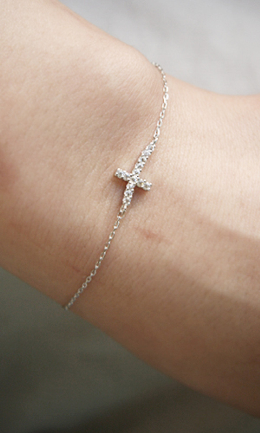 Swarovski Curved Sideways Cross Bracelet White Gold
