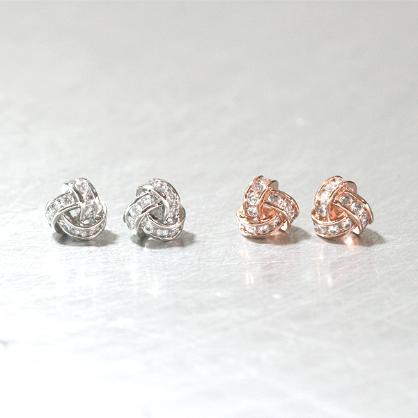 Swarovski White Gold Triangle Knot Earrings Studs from kellinsilver.com