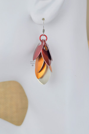 Fire Dangling Shields in aluminum, by Infinitus Designs