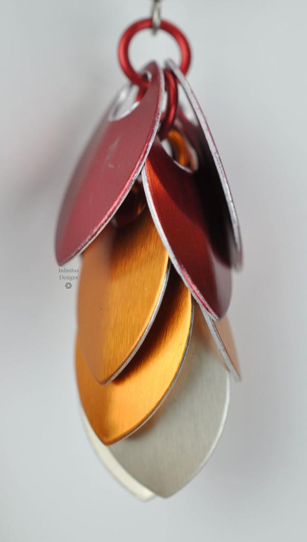 Fire Dangling Shields in aluminum, by Infinitus Designs