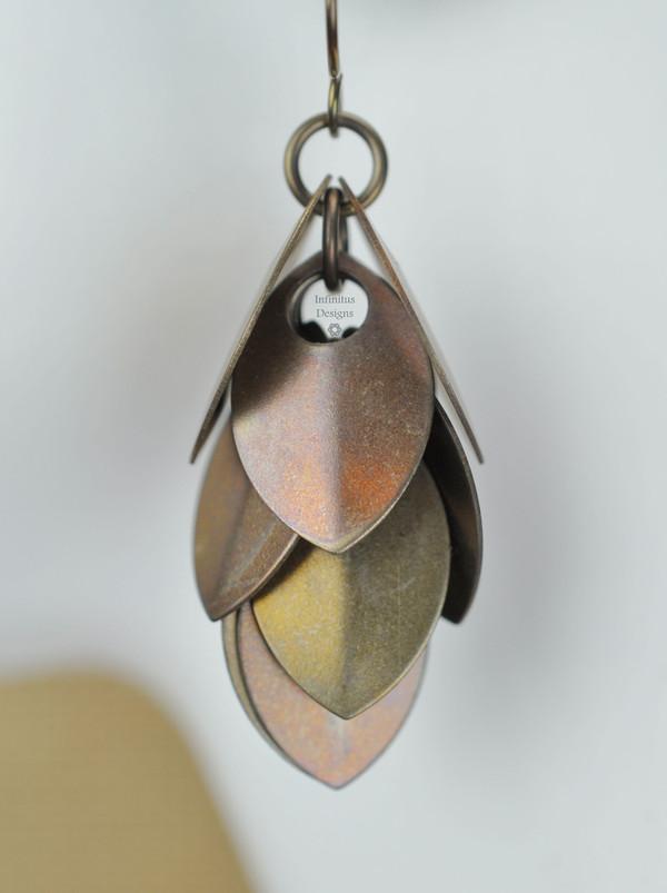 Bronze Dangling Shields in titanium, by Infinitus Designs