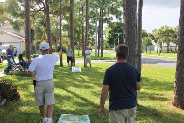 Play Cornhole with family & friends