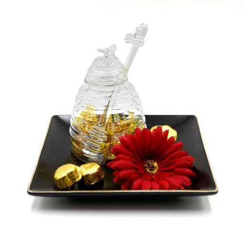 honey dish on ceramic plate