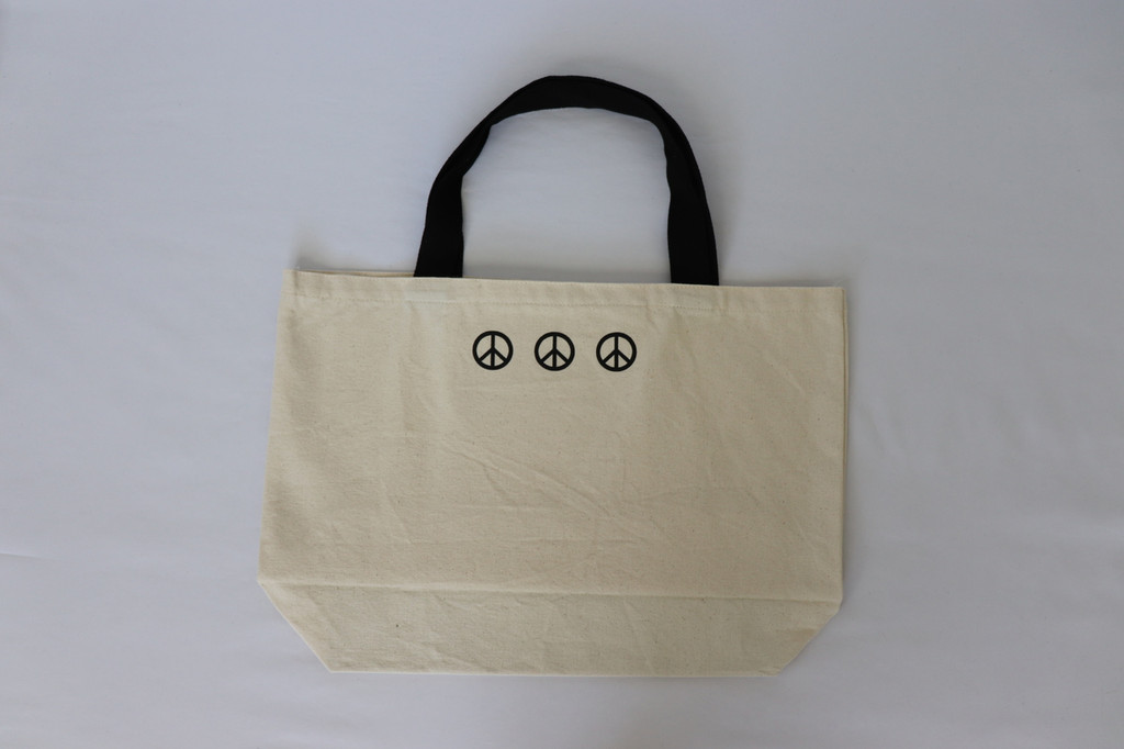 PEACE. NATURAL CANVAS TOTE with 3 PEACE SIGNS on back.