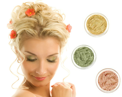 beautiful-woman-showing-mineral-eyeshadow-color-variety.jpg