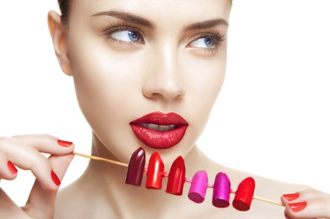woman-holding-lipstick-bullet-colors-toothpick.jpg