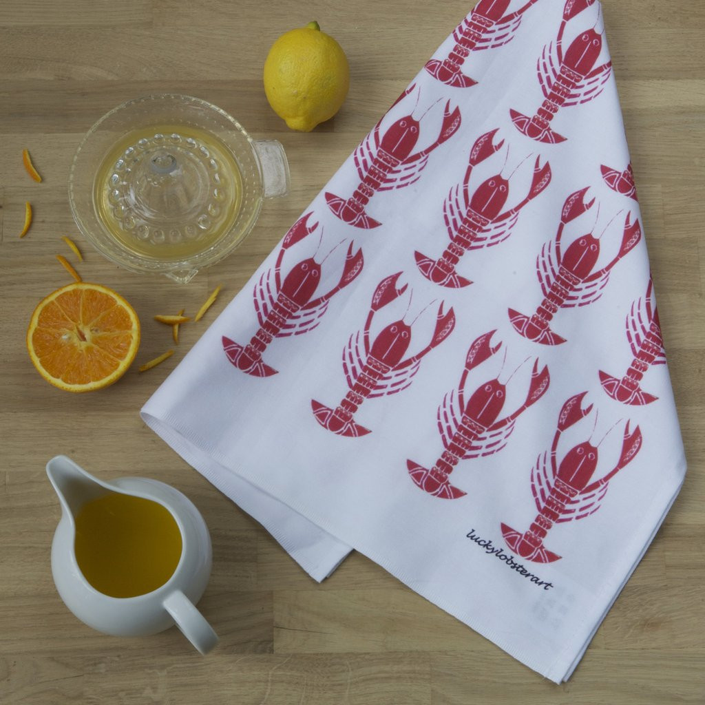 Lobster tea towel with design from the original lino print artwork from Lucky Lobster Art in England.