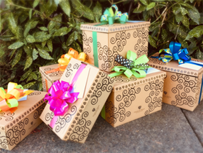 Several signature Green & Green gift boxes with colourful bows.