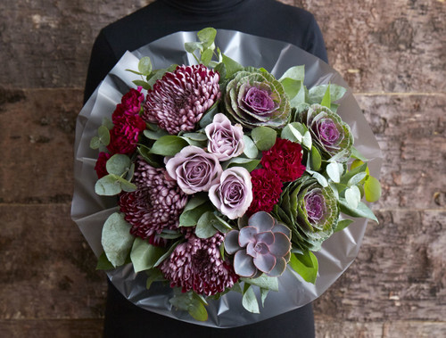 There is no need to forage for these gorgeous 'Mushroom Mauve' blooms, we created this perfectly purple display by gathering to-die-for 'Sheer Purple' Chrysanthemum blooms, vintage toned 'Memory Lane' roses alongside clusters of burgundy carnations, brassicas together with a statement succulent plant for a richly romantic bouquet.   Like all of our bouquets, 'Mushroom Mauve' is expertly made by one of our talented florists using the highest quality flowers, beautifully gift wrapped and finished with a hand written card.
