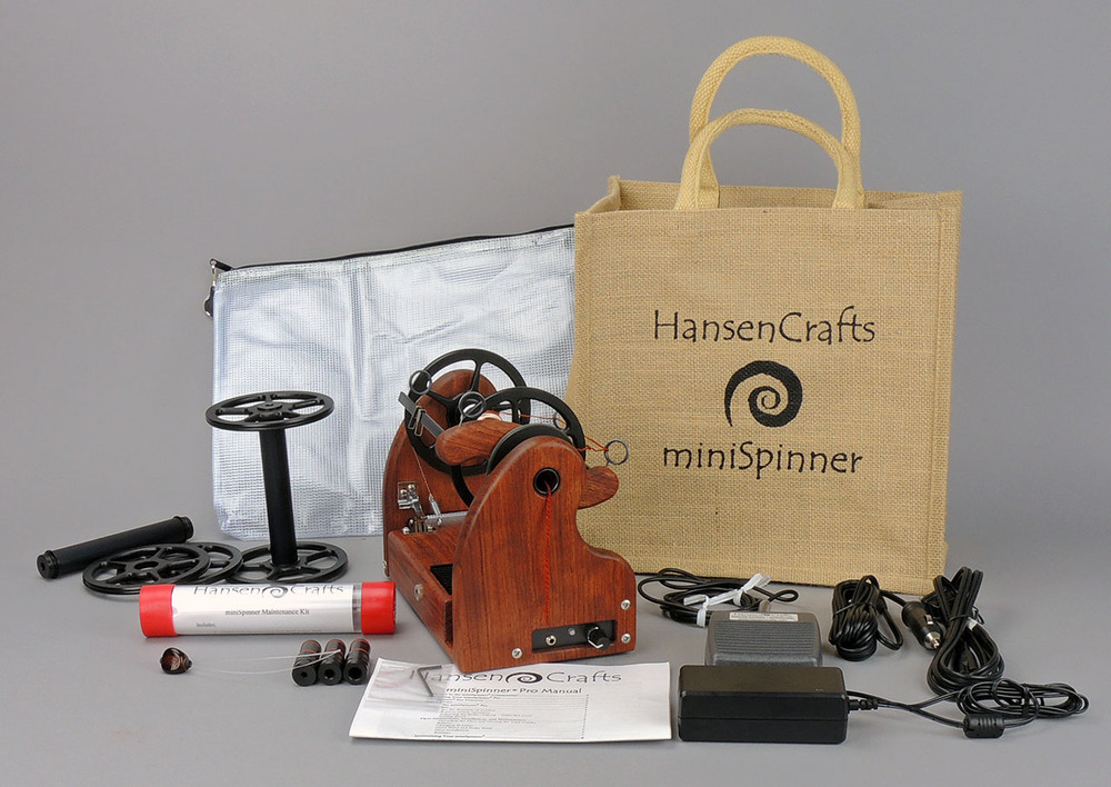 The Ultimate E-Spinner, the HansenCrafts miniSpinner Pro, in Bubinga! The Pro includes 2 additional HansenCrafts Standard or 3 additional HansenCrafts Lace bobbins, gear bag, maintenance kit, and orifice reducer set.
