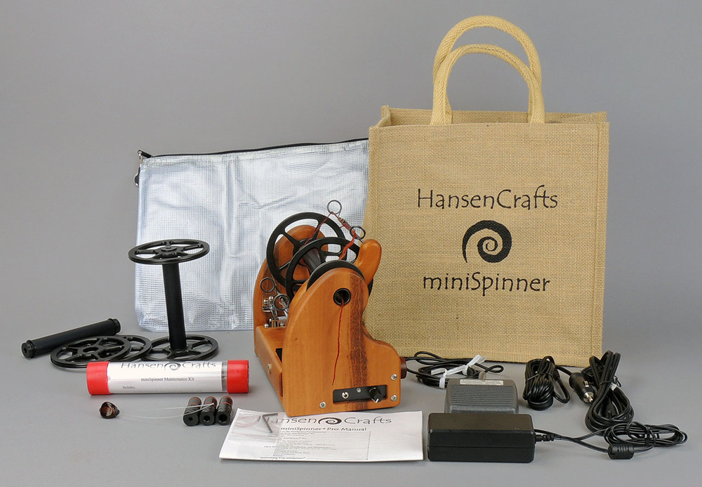 The Ultimate E-Spinner, the HansenCrafts miniSpinner Pro, in Tigerwood! The Pro includes 2 additional HansenCrafts Standard or 3 additional HansenCrafts Lace bobbins, gear bag, maintenance kit, and orifice reducer set.