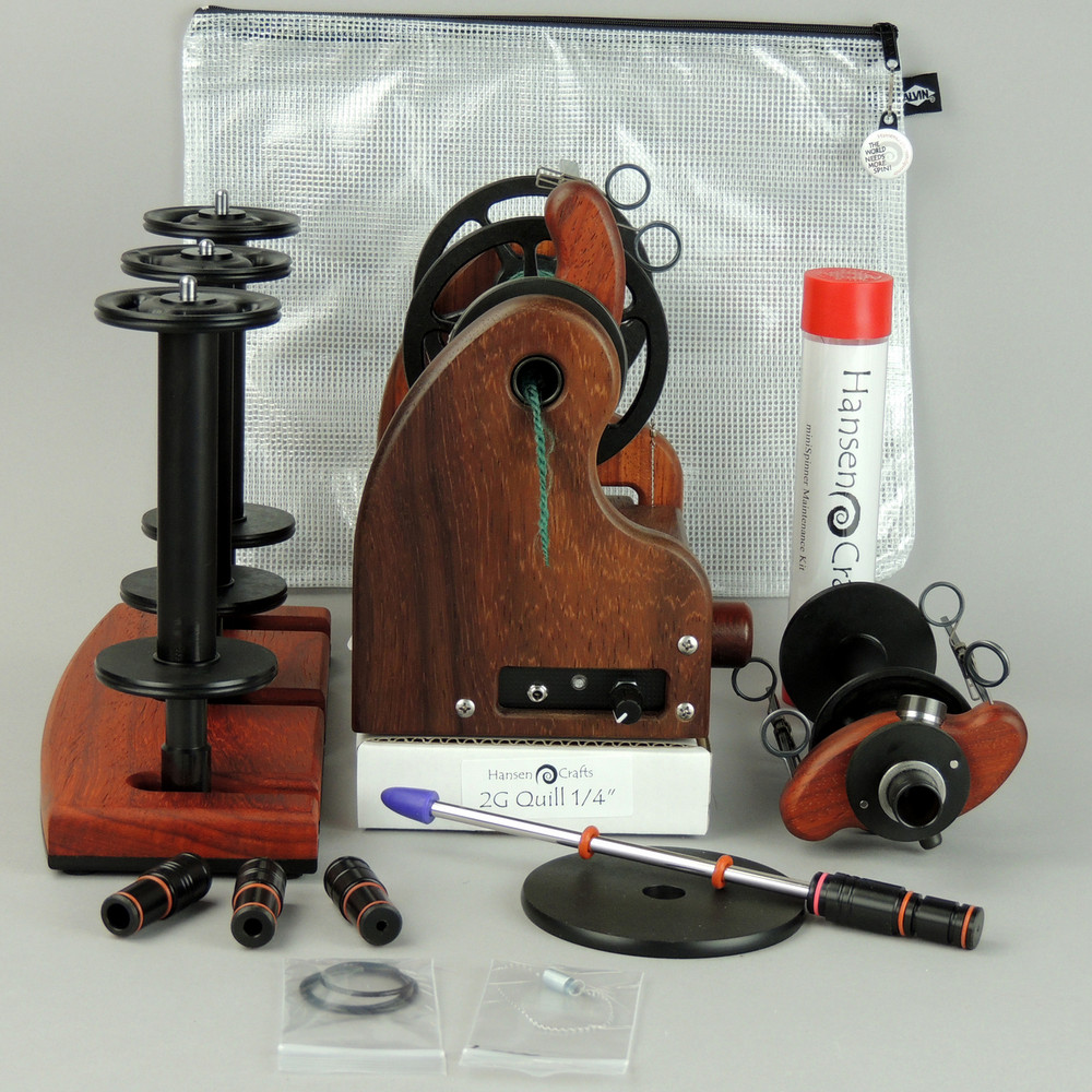 """The HansenCrafts Bundle includes; a Classic miniSpinner with the HansenCrafts Standard Flyer, Lace flyer, Maintenance kit, 3 extra HansenCrafts Lace bobbins, 2 or 3 ply Lazy Kate (your choice), Orifice reducer set, Quill - 1/4""""-6mm, and a Gear/Accessory bag."""