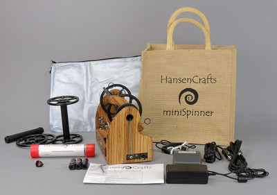 The Ultimate E-Spinner, the HansenCrafts miniSpinner Pro, in Zebrawood! The Pro includes 2 additional HansenCrafts Standard or 3 additional HansenCrafts Lace bobbins, gear bag, maintenance kit, and orifice reducer set.