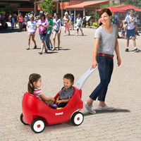 Simplay3 High Back Wagon for toddlers includes deluxe features like durable, deep tread rubber tires for quiet rides, and front caster wheels for easy turns around tight corners.