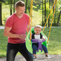 Simplay3 Green Snuggle Swing attached to swing set with father pushing child