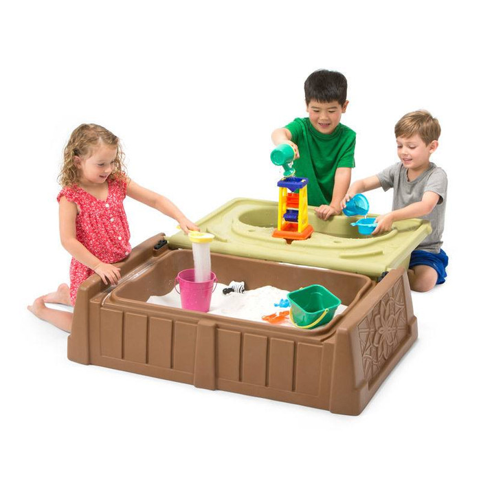 Simplay3 Sand and Water Bench for children opens to a large sand and water play center.