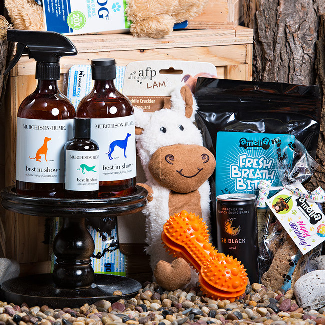Yes we have the perfect gift for Man's Best Friend. Packed full of treats, toys and organic, paraben free grooming aids! Daddy will love the crate once it comes knocking at his door. We even included an all-natural energy drink for daddy-he will need it for those long walks with Fido. Gift Includes: •	Keepsake Canadian Made Manbox •	Bowldog Portable Dog Bowl •	Pet Drying Gloves •	Between Clean Waterless Dog Wash-Lavender and Lemongrass •	Fresh Coat Moisturizing Dog Shampoo- Infused With Lavender •	Gloss + Groom Dog Conditioner With Lemongrass oil, Geranium oil &  Lavender oil •	Fresh Breath Bites  •	Canadian Bacon Treaty Bites •	Dog Toy •	Toy Dog Bone •	28 Black Acai Energy Drink •	Bacon Pig 4 Piece Treaty Bite
