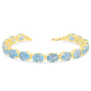 Oval Genuine Blue Topaz (9 x 7) Tennis Bracelet in Yellow Gold