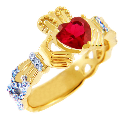 Gold Diamond Claddagh Ring with 0.40 Carats of diamonds and a Garnet Birthstone.  Available in 14k and 10k Gold.