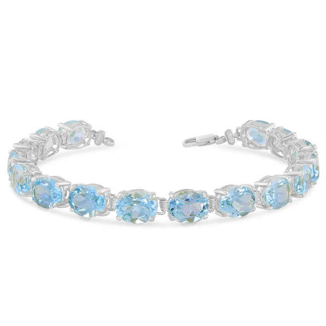 Oval Genuine Blue Topaz (9 x 7) Tennis Bracelet in White Gold