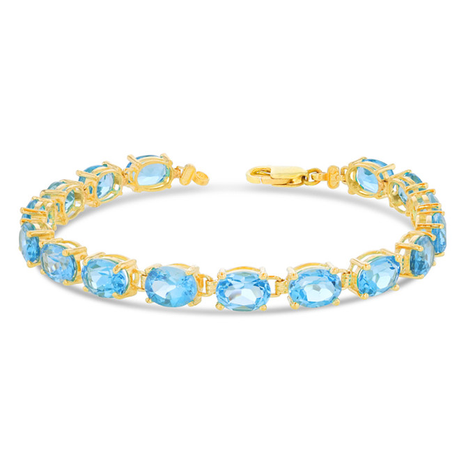 Oval Genuine Blue Topaz (8 x 6) Tennis Bracelet in Yellow Gold