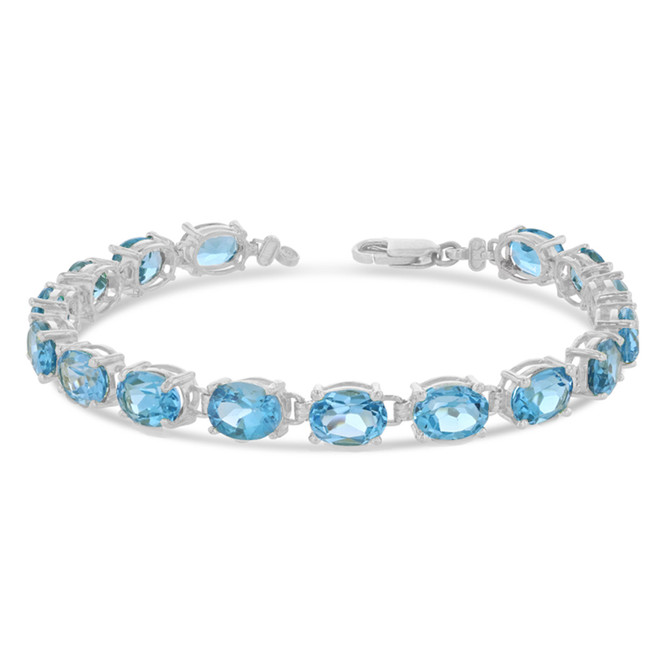 Oval Genuine Blue Topaz (8 x 6) Tennis Bracelet in White Gold