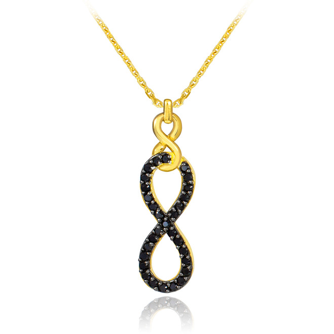 Vertical infinity necklace with black diamonds in 14k gold.