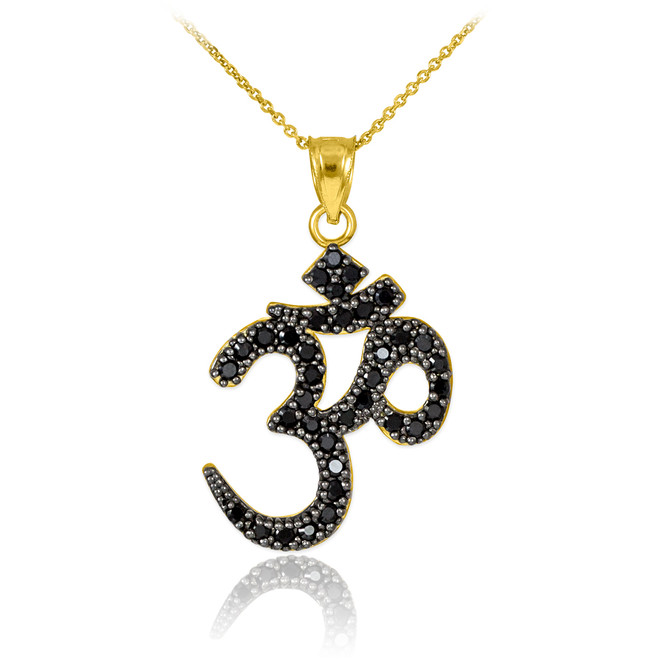 Black cz Ohm/Om pendant necklace in 14k yellow gold.