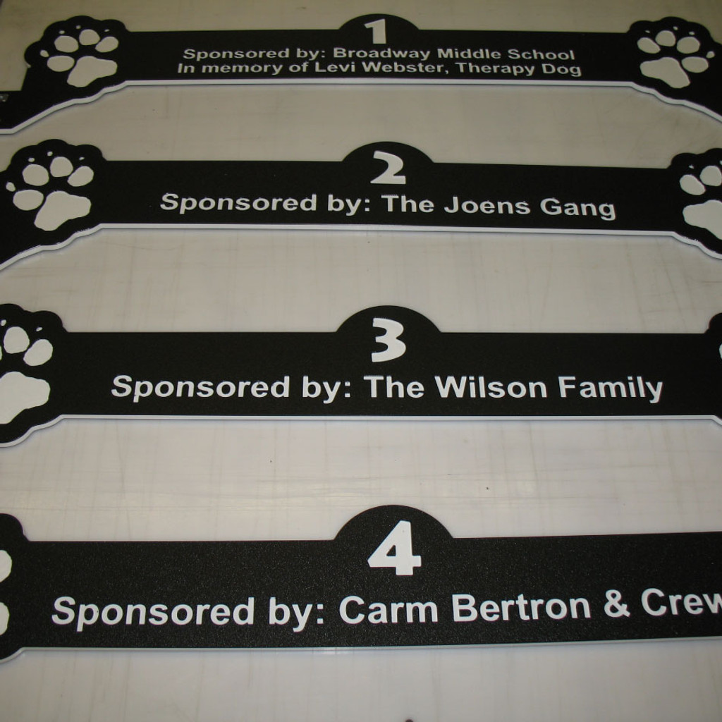 paw-prints and names of the sponsors for the animal rescue.