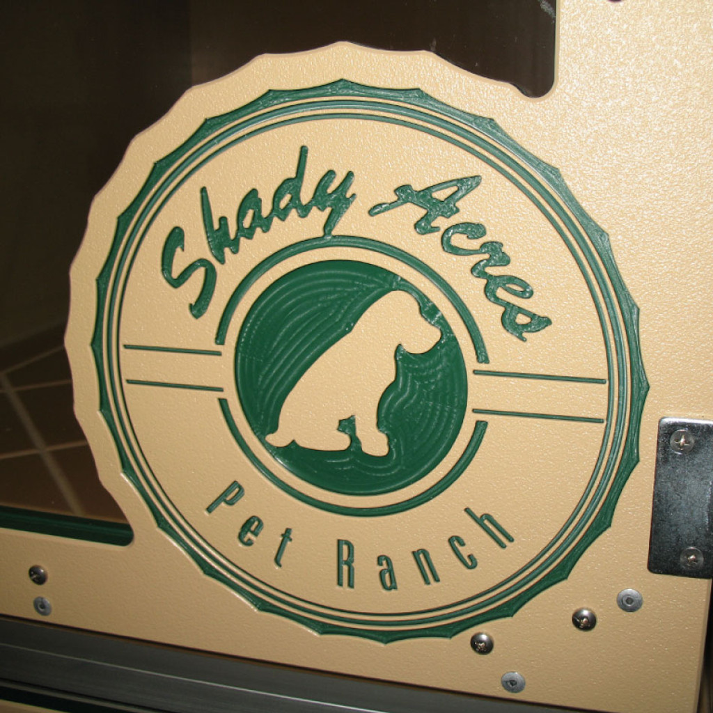 Shady Acres Pet Ranch Logo engraved on the kennel gate.