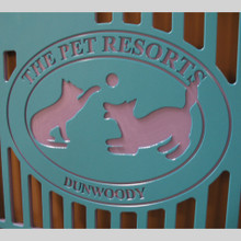 The Pet Resorts Logo engraved on their kennel gates.