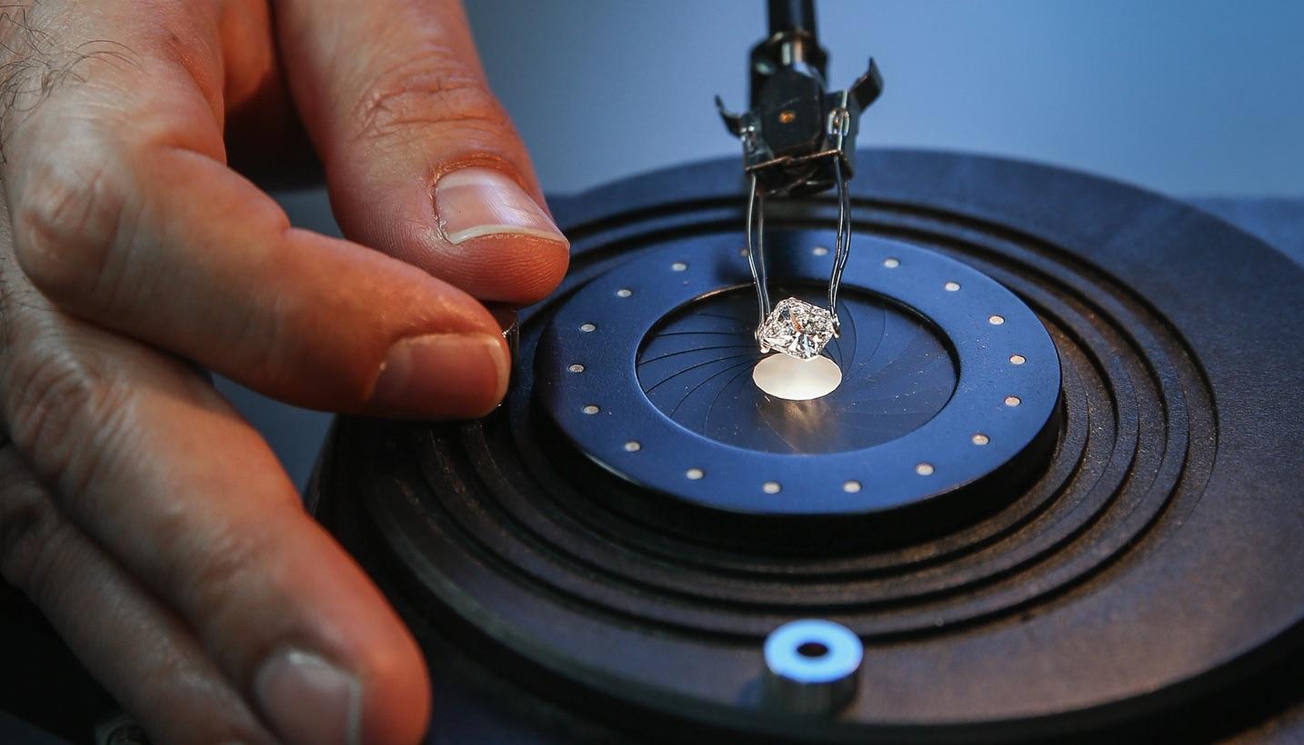 a jewelry craftsman vetting a diamond