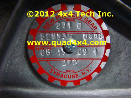 Round Data Tag for New Process and New Venture Transfer Cases showing Model Number, Assembly Number, Build Date, and Ratio. May also have serial number