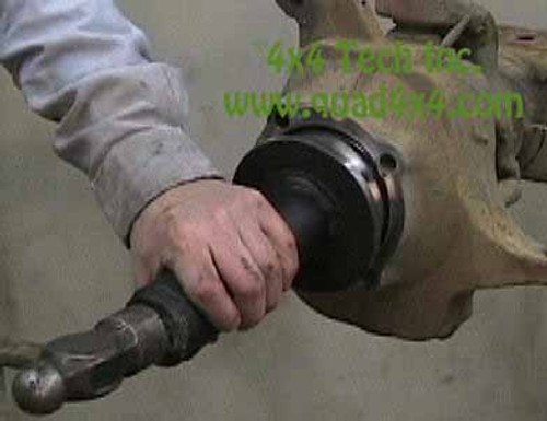 Using QT1515 Knuckle Seal Installer to seat the axle shaft assembly into the steering knuckle to correct depth