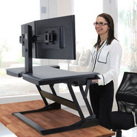 WorkFit-T/TL Sit-Stand Desktop Workstation in use - color black