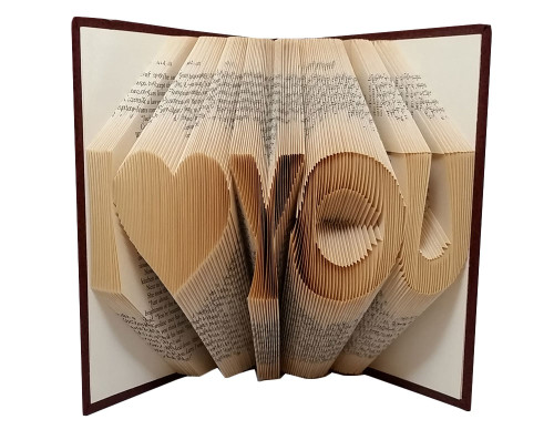 "A folded book piece with a design that says ""I heart you"""