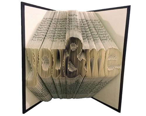 "Folded book art with a design that read ""you & me"""