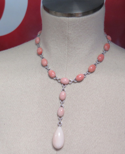 A stunning 18ct white gold 2.12ct diamond & angel skin coral necklet Val $19900