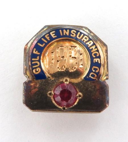 "1951 14K GOLD, GARNET & ENAMEL ""GULF LIFE INSURANCE Co"" USA SMALL BADGE."