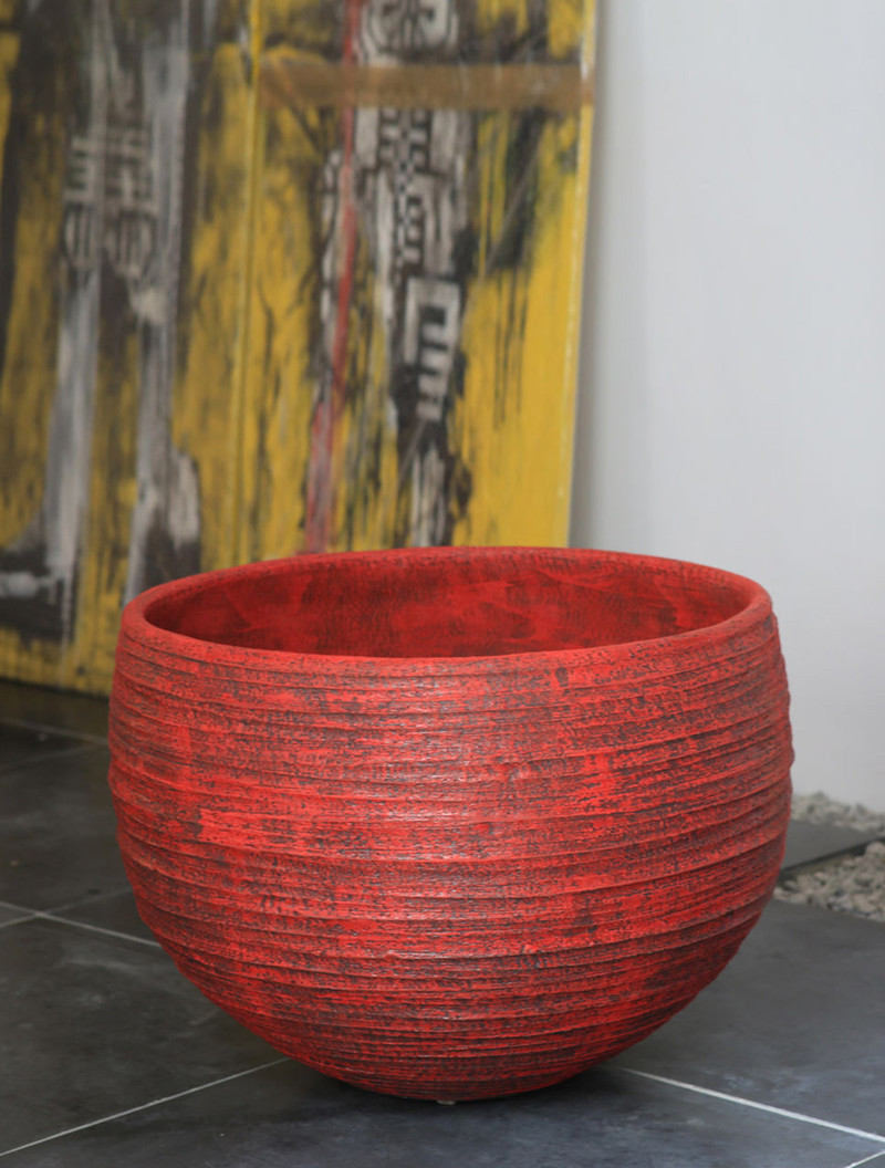 MILOS POT        IN/OUTDOOR - TERRACOTTA  The MILOS collection is created by the modeling technique of leaving extra finger imprint on the clay whilst turning. The unique sense of naturalness is intensified through the dying process using colored silt by 'angoben', which is known for not glazing during baking, resulting in a beautiful matte finish.  Basic colours: white, black, brown. Special colors like red, green etc. are also possible.