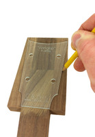 """An example of the """"Wingtip"""" template placed on one of our extended headstock neck blanks, ready for tracing."""