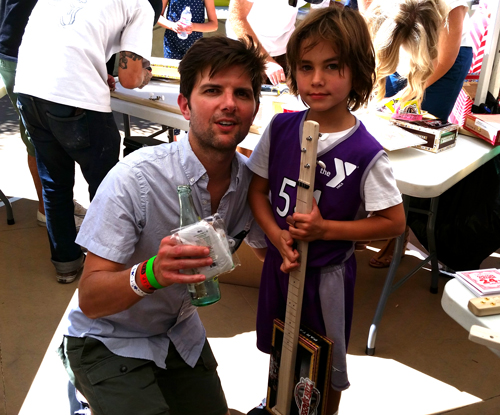 adam-scott-and-son-holding-a-pure-simple-cigar-box-guitar.jpg