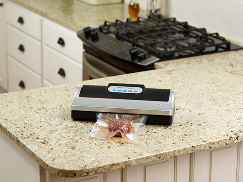 VacMaster PRO110 vacuum food sealer to vacuum package in home kitchen
