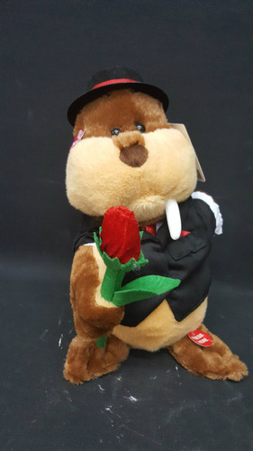 "Waldo, our romantic walrus who presents a single red rose.  He dances to and sings ""Forget You""!"