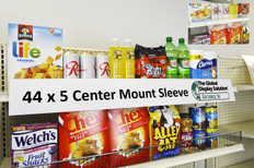"""Sign protector clips into standard 1.25 inch channels and displays large 44""""w x 5""""h signs on retail shelves."""