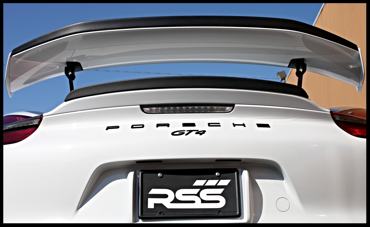 RSS - CarbonAero Kit # 250 for 981 GT4. Includes FRONT CANARDS / DIVE PLANES, REAR WING EXTENSION AND REAR DUCK TAIL EXTENSION. Aesthetically pleasing and aggressive in appearance, Canards and WING EXTENSIONS have a functional purpose with direct benefits on street and motorsports applications. Designed with the latest CAD technology, constructed to exacting standards with pre-preg 2×2 Carbon Fibre Twill, finished in a Matte Clear Coat with UV inhibitors, adhere with 3M VHB tape for easy application and removal, and are 100% Manufactured in USA. Components are of the highest quality and are guaranteed to fit.• Produce down force by deflecting oncoming air upward resulting in a net down force on the front and rear of the vehicle • Can direct air towards other important aero devices or cooling vents • Direct air away from the wheels and tires thereby reducing drag, turbulence and lift • Can be used to balance and tune front to rear down force levels