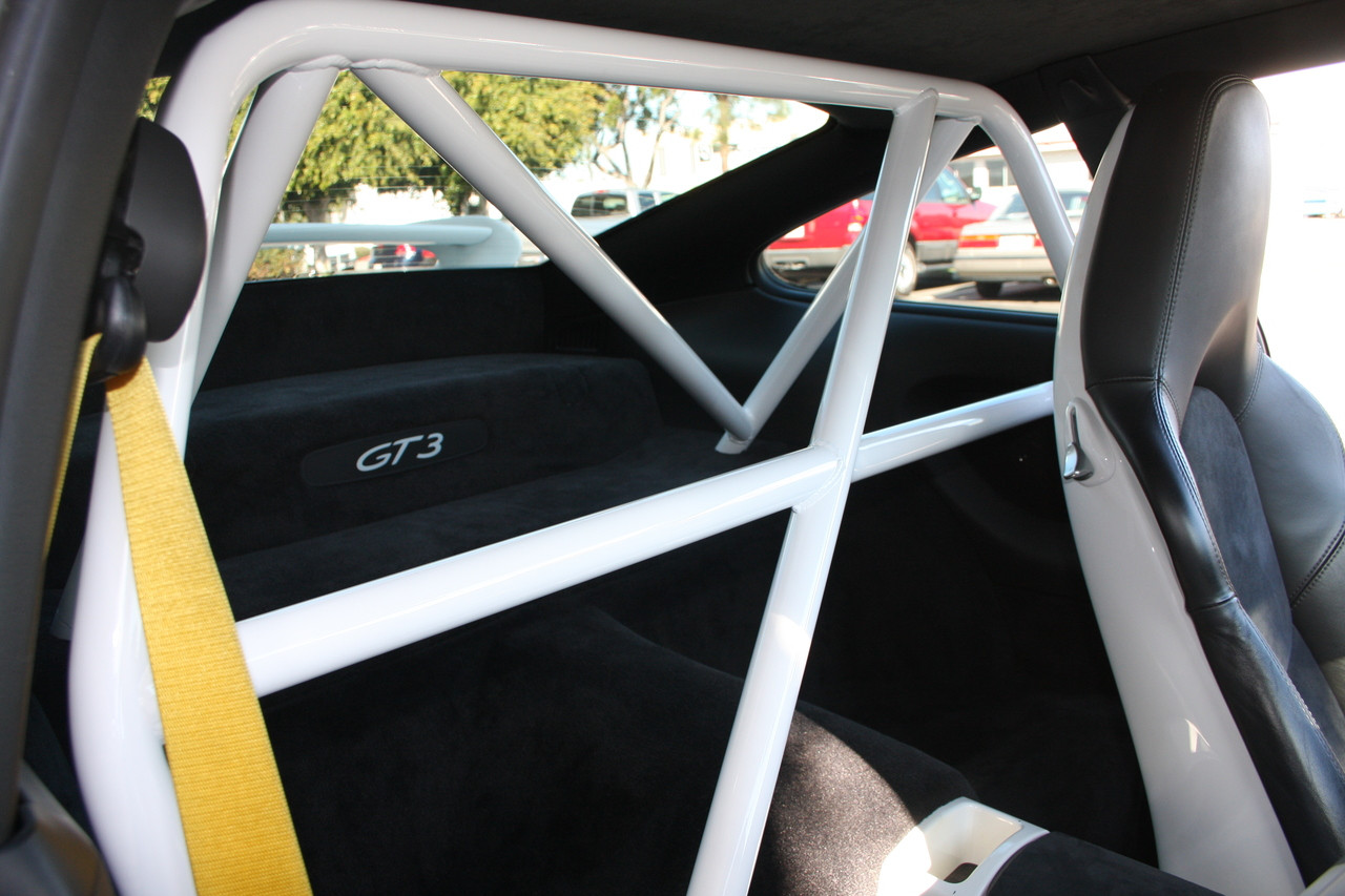 """• Fits ALL 996 & 997 MK1 & MK2 Models Including GT3 & GT3 RS • 1.5"""" Steel Tubing, .095 Wall Thickness, 38 lbs including all hardware • Bolts To Front Seatbelt Mounts & Rear Shock Towers • Mig Welded, No Sleeved Tube Connections • Flawless Fit To Interior Profile • Retains Full Function of Most Seats • Offers Safety, Harness Connection & Motorsport Looks • Available in Standard Black (30), White (32), or Raw (00) (unfinished - ready for paint match) • Contact Us for Additional Custom Colors • Easy Bolt-In Installation – No Drilling Required • Handmade on Location in Southern California, USA • Will Fit In Vehicles with Sunroof • Please Enter Color Choice in Comments Section in Shopping Cart Note: Modifications Need to Be Made On Models with Bose® Rear Subwoofer. Note: Rollbar Ships On A pallet, Shipping withing Continental USA is typically $200-$300. We Will Contact You with Final Shipping Quote Via FedEx Freight."""