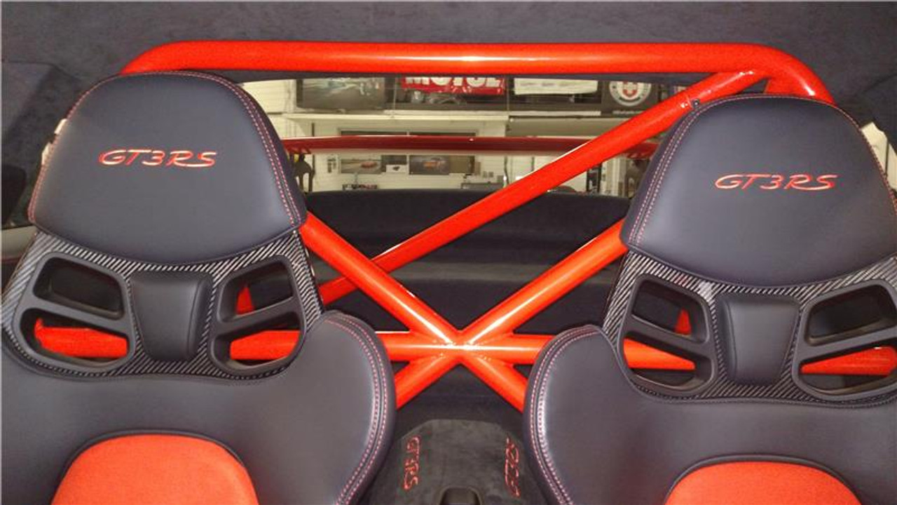 """RSS 940-XC Series 4pt. Roll Bar (991 GT3 / RS & 991 Without Sunroof/Moonroof)  o The RSS 940-XC Series 4pt. Roll Bar features the """"X-Cross"""" main hoop design providing superior occupant protection  o The XC's one piece Main Hoop mounts to a reinforced chassis cross member at the B Pillar which runs the full width of the vehicle. Unlike other designs, the Main Hoop has a maximum of four bends featuring a Straight Top Tube Section forming a stronger more rigid main hoop.  o The 940-XC is a safety inspired design which mounts shoulder harnesses directly behind the occupants attaching at the main hoop horizontal bar. The main hoop mounting position greatly enhances safety by reducing the effects of """"Harness Stretch."""" Harness Stretch is a serious safety concern commonly overlooked with other designs.  What is Harness Stretch? Simply put, safety harness-belts allow a certain percentage of stretch during a rapid deceleration event, the longer the harness-belt, the more overall stretch it will allow. This unsafe forward movement can be dangerous, especially when airbags deploy. By significantly shortening harness-belt length (mounting to main hoop vs. rear compartment of vehicle) occupant torsos are securely anchored against the seats reducing this unwanted excessive forward movement.  o Rear Down Tubes feature precision cut and reinforced mounting plates that attach to rear shock towers incorporating all three shock mounting points, maximizing contact area to evenly distribute load.  o The Rear Diagonal Brace provides additional main hoop and rear shock tower triangulation and increases chassis rigidity.  o The 940-XC allows full seat base travel with standard seats, OE buckets or racing buckets and allows full use of factory seat belts. (Easily fits 6'4 inch driver in Recaro SPG XL Racing Seat).  o Bolt-In Installation does not require drilling of chassis or cutting of interior side panels common with other bars. The Bar uses vehicles existing hardware, carpet panel trimmi"""